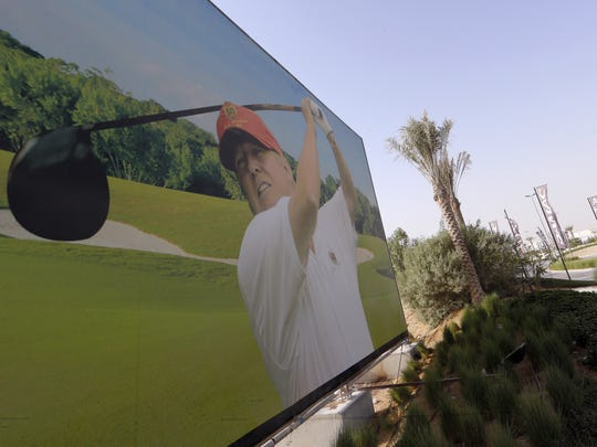 US real-estate magnate Donald Trump is seen playing golf on a billboard at the Trump International Golf Club Dubai in the United Arab Emirates on August 12, 2015. The empire of White House hopeful Donald Trump outside the United States extends to 12 countries including Turkey, South Korea, India, Brazil, and the United Arab Emirates. AF