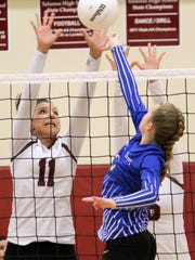 Tularosa's Alex Veyna, left, prepares to block a shot from a Mesilla Valley Christian player Tuesday night.
