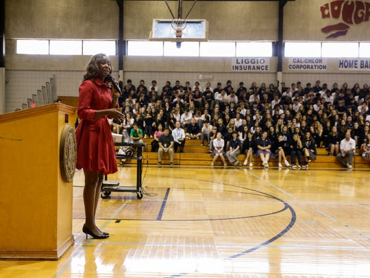"""Immaculee Ilibagiza, a Rwandan genocide survivor and New York Times best-selling author of """"Left to Tell,"""" speaks to St. Thomas More students Sept. 21, 2016 in Lafayette."""