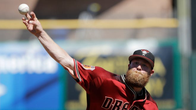 Arizona Diamondbacks' Archie Bradley throws during the first inning of a spring training baseball game against the San Francisco Giants, Sunday, March 12, 2017, in Scottsdale, Ariz.