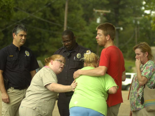 Family members comfort Connie LeBlanc (center), the mother of Christopher Shane LeBlanc, who was killed Monday morning in an altercation with Pineville Police on Cummins Street in Pineville. LeBlanc's wife, Tanya LeBlanc, stands to the right.