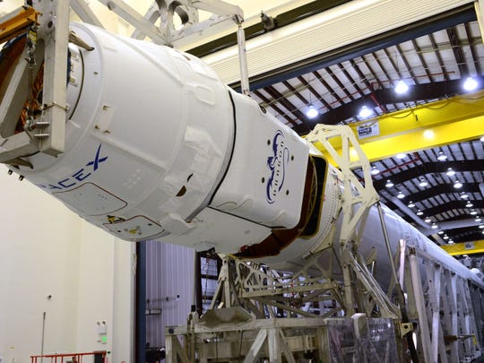 SpaceX Dragon capsule being mated to the Falcon 9 rocket ahead of SpaceX's last cargo mission to the space station. Another SpaceX Dragon is set to launch from the Cape on Saturday morning.