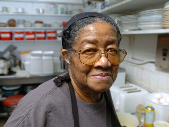 Stella Dunning, shown in the Knotty Pine Restaurant kitchen in 2008, fed diners from top stars to the poor of Wilmington's East Side.
