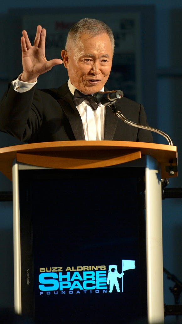 Special guest George Takei addresses the audience during Saturday's ShareSpace Foundation Gala in the Apollo/Saturn V Center at Kennedy Space Center.