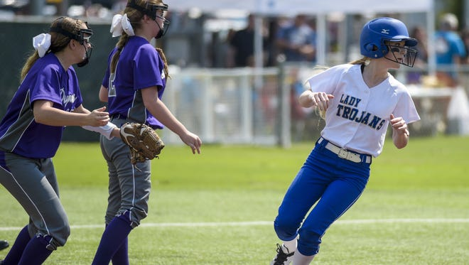 Sacred Heart outfielder Laura Beth Fontenot (12) takes second base off of a hit during a quarterfinal game against Mangham in the LHSAA Fast Pitch 56 State Softball Championship tournament at Frasch Park in Sulphur, LA, Friday, May 1, 2015.