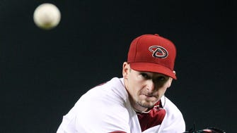 Diamondbacks pitcher Allen Webster (27) makes a pitch against the Los Angeles Dodgers in the first inning at Chase Field in Phoenix, AZ, on Monday, June 29, 2015.