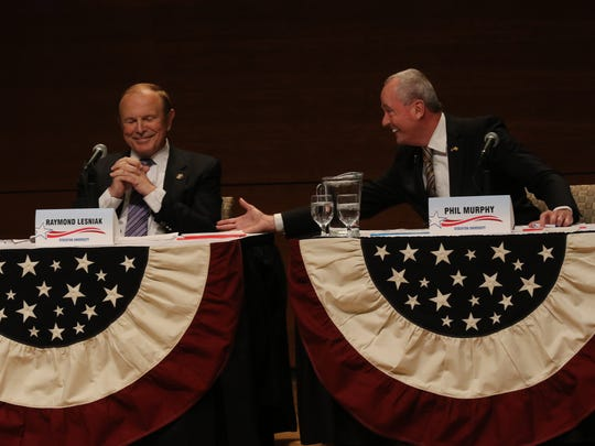 Democratic candidates Ray Lesniak and Phil Murphy enjoy a lighter moment during the Democratic debate.