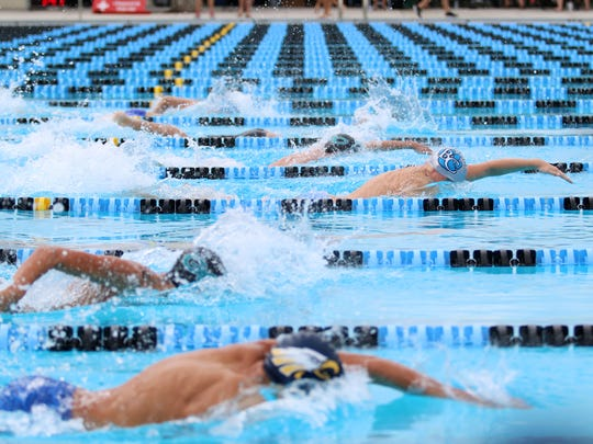 A Barron Collier swimmer holds the lead during the 200 yard boys freestyle race at the Collier County Athletic Conference swimming and diving championships at Norris Pool in Naples, Florida on Saturday, Oct. 7, 2017.