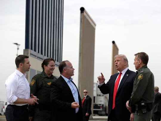President Trump speaks during a tour as he reviews border wall prototypes in San Diego March 13, 2018.