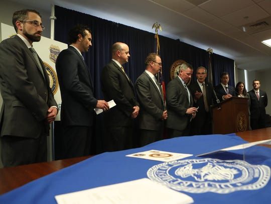 U.S. Attorney David Weiss holds a press conference