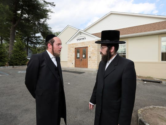 Airmont residents Yehuda Zorger and Eliezer Halberstam, Rabbi of Bais Hamedrash Radashitz, an Orthodox synagogue on Echo Ridge Road in Airmont, stand in front of Halberstam's synagogue May 8, 2018. Both men feel that the Village of Airmont is enforcing their fire and safety codes in a way that targets the Hasidic Jewish community.
