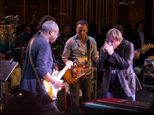 David Sancious (left) plays guitar next to Bruce Springsteen and Southside Johnny Lyon at the Upstage Jam, Friday, April 21 at the Asbury Park Music and Film Festival in the city's Paramount Theatre.