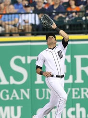 Detroit Tigers Mikie Mahtook catches a fly ball hit