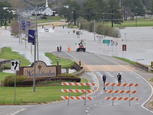 People look at the flooded intersection of Highway 1 and Highway 6  in Natchitoches Thursday. The intersection was closed due to flooding.
