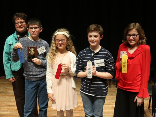 Bryce James, Makenna Lucas, Spencer Heintz and Grace Draeger finished as the top four spellers at the Ottawa County Spelling Bee on Tuesday.