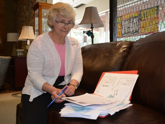 Sales Associate Joann Zirtzlaff scans paperwork in the furniture section of the Sturgeon Bay Younkers. She has worked at the store for 26 years.
