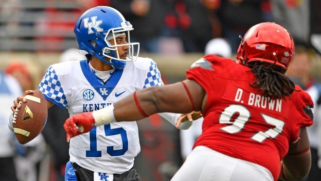 Nov 26, 2016; Louisville, KY, USA;  Kentucky Wildcats quarterback Stephen Johnson (15) looks to pass during the first quarter the Louisville Cardinals at Papa John's Cardinal Stadium.