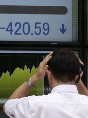 A businessman holds his head in front of the closing