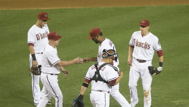 Diamondbacks' manager Chip Hale pulls Enrique Burgos from the mound after giving up a game-tying home run to the Giants' Hunter Pence at Chase Field in Phoenix, AZ on July 17, 2015.
