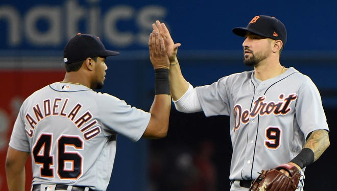 Nicholas Castellanos, left, celebrates with Jeimer Candelario after defeating the Blue Jays, 9-1, to end an 11-game losing streak Sunday.