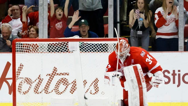 Feb 18, 2017; Detroit, MI, USA; Red Wings goalie Petr Mrazek celebrates after he makes the save on Capitals left wing Alex Ovechkin to secure a 3-2 shoot-out win at Joe Louis Arena.