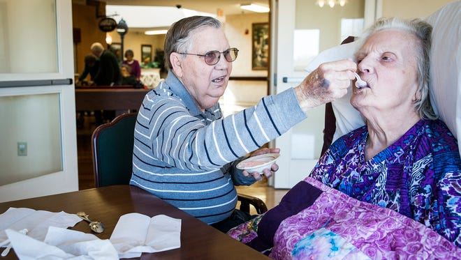 Berlin Rowe feeds his wife, Ruth, at Morrison Woods in Muncie Thursday. Ruth, who has dementia, suffered a major stroke several years ago.