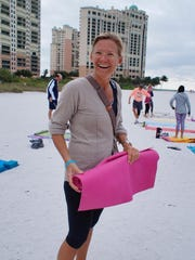 Karen Benson comes to Marco from Stockholm, Sweden, three times a year. She is a regular at the Marco Beach yoga class.