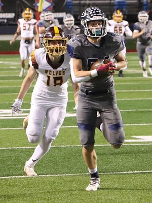 Luke Brewer (84) of Greenwood outruns Lake Hamilton's Ethan Watson earlier this month at Little Rock's War Memorial Stadium. Greenwood defeated Lake Hamilton, 49-24, for the 6A state title.