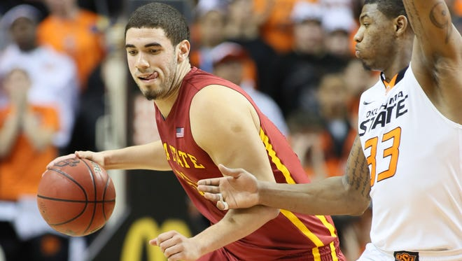 Iowa State Cyclones forward Geroges Niang (31) drives against Oklahoma State Cowboys guard Marcus Smart (33) at Gallagher-Iba Arena. Iowa State defeated Oklahoma State 98-97 in triple overtime.