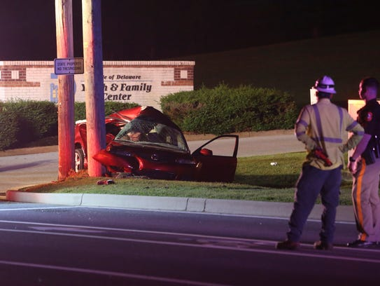 A car rests against a utility pole after crashing on
