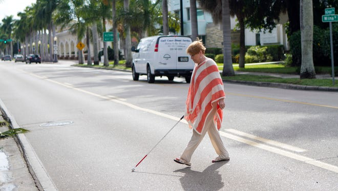 Crossing MgGregor Boulevard to get to church is an ordeal for Kathleen Hoover.