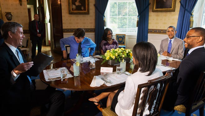 President Barack Obama, right, and Education Secretary Arne Duncan, far left, speak with teachers about education, Monday, July 7, 2014, in the Blue Room of the White House in Washington. From left clockwise are, Duncan, teachers Justin Minkel, and Leslie Ross, President Obama, teachers Dwight Davis and LeShawna Coleman.