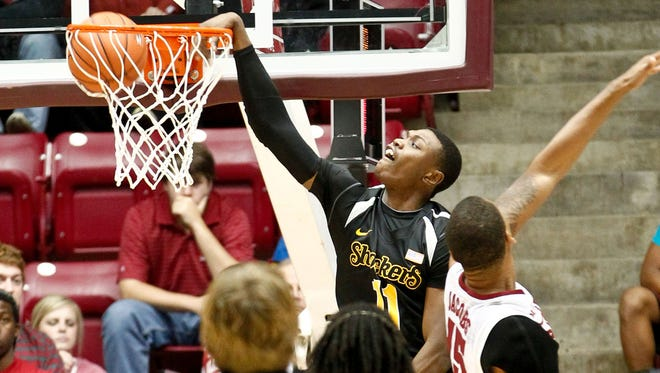 Wichita State forward Cleanthony Early throws down a dunk against Alabama.