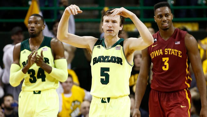 Baylor Bears guard Brady Heslip celebrates against the Iowa State Cyclones during the second half of a mens basketball game at The Ferrell Center.