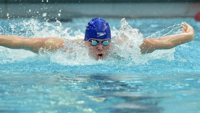 Sartell senior Spencer Sathre competes in the 100-yard butterfly during the boys Class A swimming and diving championship meet Saturday at the University of Minnesota Aquatic Center in Minneapolis.