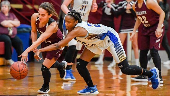 Henderson's Jaylee Carter (5) gets a steal from Caldwell County's Jada Boyd (21) as the Henderson County Lady Colonels play the Caldwell County Lady Tigers in the Second Region Tournament in Dixon Tuesday, February 27, 2018.
