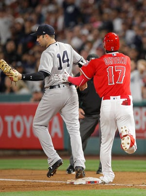 Shohei Ohtani sprained his ankle while trying to avoid a collision with Yankees first baseman Neil Walker on Friday.