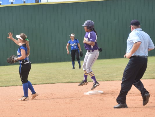 LSUA's Kim Gonzalez (8, front center) hit a double against Williams Baptist College in a NAIA National Championship Tournament held Tuesday at LSUA.