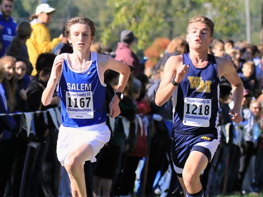 Salem's Luke Haran (left) and a Wayne Memorial runner compete at the county meet.