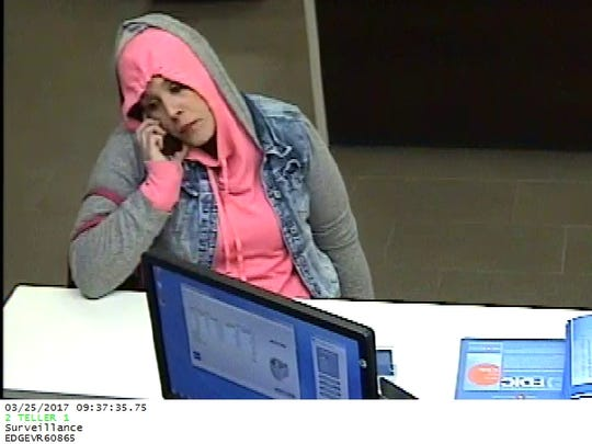 Police arrested this woman for robbing a bank in Brookfield Monday.
