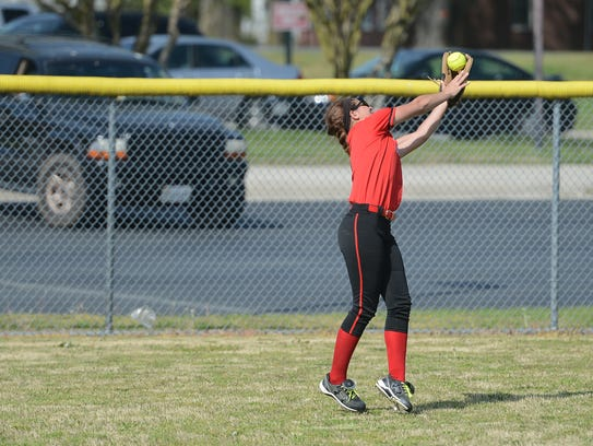 Arcadia's Victoria Coll snags a fly ball in left field