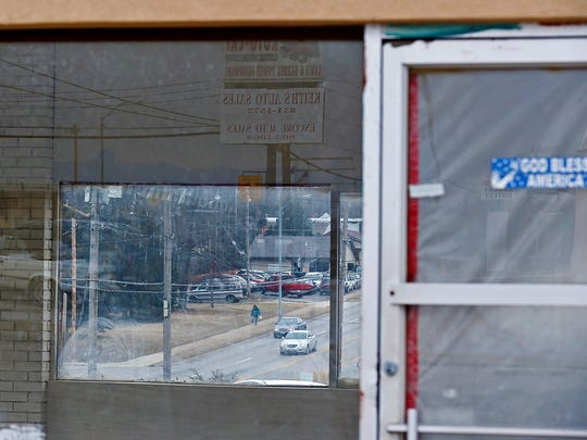 A portion of Kearney Street is seen through the windows an abandoned car sales office in north Springfield, Mo. on Feb. 8, 2017.