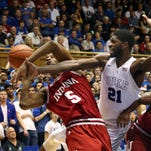Duke Blue Devils forward Amile Jefferson (21) and Indiana Hoosiers forward Troy Williams (5) scramble for the ball in their game at Cameron Indoor Stadium.