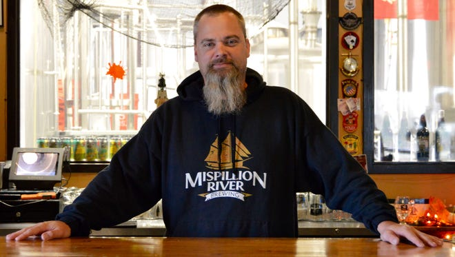 Eric Williams poses in his Milford brewery, Mispillion River Brewing.