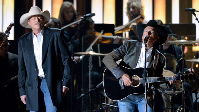 NASHVILLE, TN - NOVEMBER 06: Alan Jackson and George Strait perform onstage during the 47th annual CMA Awards at the Bridgestone Arena on November 6, 2013 in Nashville, Tennessee.  (Photo by Rick Diamond/Getty Images)