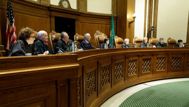 In this Sept. 7, 2016, file photo, Justices on the Washington state Supreme Court listen during a hearing in Olympia, Wash. Political groups are engaging in a high-stakes battle for institutions that were once considered above politics: state supreme courts. Both liberal and conservative groups now view control of the high courts as essential to either defending or thwarting state laws.