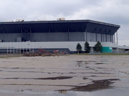 With sections missing from what had been the inflated roof of the Pontiac Silverdome, weather has taken its toll on the former home of the Detroit Lions and its contents, with water flowing underneath the turf and pieces of roof and ceiling piled around. Picture taken May 3, 2014