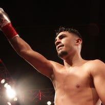 Coachella's Randy Caballero celebrates his win over Ruben Garcia of Mexico City at Fantasy Springs Casino in Indio on February 5, 2016. Caballero won the bout via a TKO.
