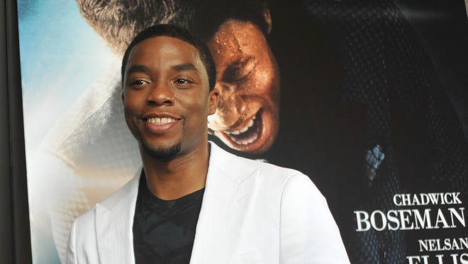 """Chad Boseman, star of the James Brown biopic 'Get On Up,"""" makes his way along the red carpet during Sunday's screening at the Malco Grandview Cinema in Madison Sunday."""