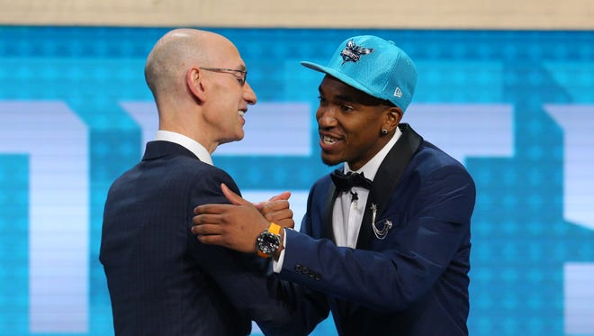 Jun 22, 2017; Brooklyn, NY, USA; Malik Monk (Kentucky) is introduced by NBA commissioner Adam Silver as the number eleven overall pick to the Charlotte Hornets in the first round of the 2017 NBA Draft at Barclays Center.